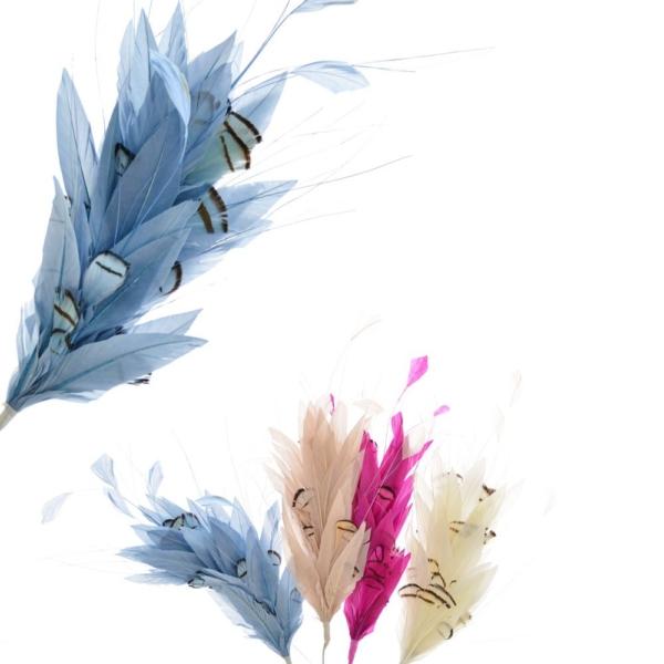 Pomo Aneto, fabricado con plumas de gallo y perdiz francesa